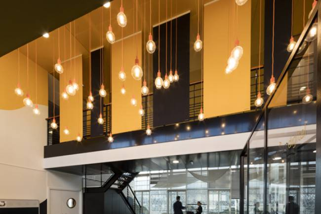 the panels follows the rhythm of the suspended ceiling tiles