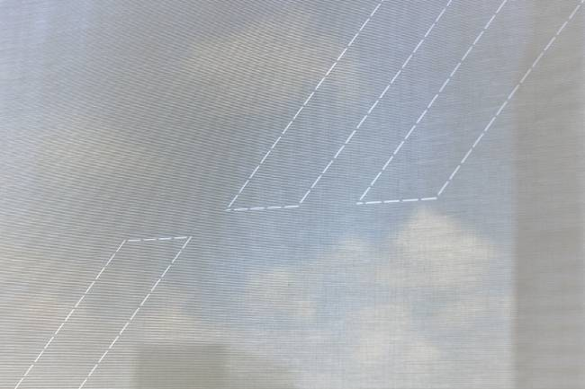 Detail of roller blinds in sun screen fabric