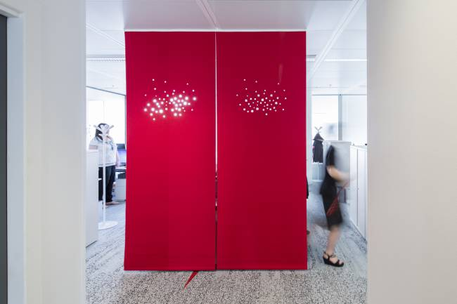 """Space dividers in red felt with """"city lights"""" digital cut design."""